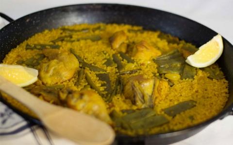 Comer paella valenciana en El Palmar